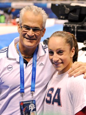 Jordyn Wieber and coach John Geddert, left, celebrate her all-around title at the World Gymnastics Championships in Tokyo on October 13, 2011.