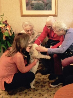 Bonnie Kaufman, left, and her dog Roy greet residents Rose Barbaccia, Margaret Michaels and Santo Calderone at Spring Hills Morristown Assisted Living.