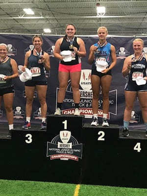Kaia Alexander (center) is awarded the national championship for women's 17-18 javelin on Sunday, July 30, 2017.