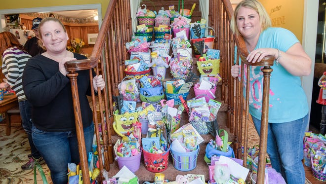 Melissa Miller (left) and Tracy Zucaro, both of Toms River, and their team of Easter bunnies, helped put together and deliver baskets to children in need this holiday.