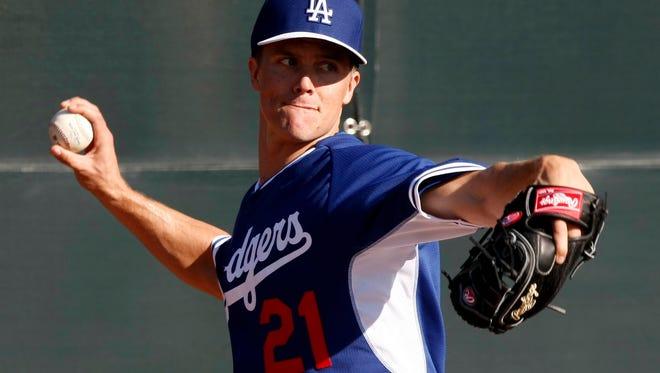 Los Angeles Dodgers starting pitcher Zack Greinke (21) throws from the bullpen during camp at Camelback Ranch on Feb. 10, 2014.