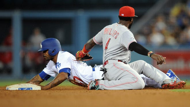 Los Angeles Dodgers second baseman Howie Kendrick (47) steals second in the fourth inning ahead of Cincinnati Reds second baseman Brandon Phillips (4) at Dodger Stadium.