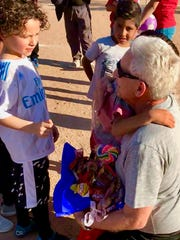 """""""I went down there and I fell in love with these children,"""" Scurran said."""