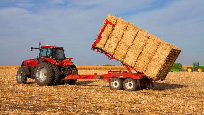 Stover is harvested in an Iowa corn field in these photos provided by Dupont.
