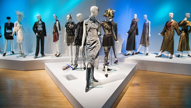 The center dress was designed by John Galliano in 2000, and is displayed at the Phoenix Art Museum's Emphatics Avant-Garde Fashion 1963-2013 exhibit, which runs from Nov. 6, 2016, to Jan. 16, 2017.