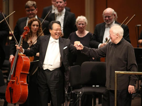 Cellist Yo-Yo Ma and Conductor Edo de Waart react during a curtain call after his concert with the Milwaukee Symphony in 2016.