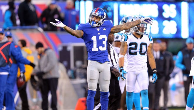 New York Giants wide receiver Odell Beckham Jr. (13) signals first down after a catch and run against the Carolina Panthers during the fourth quarter at MetLife Stadium.