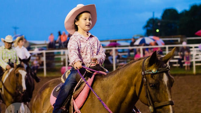 A young girl rides a horse during the sixth annual Pink for Peitz Benefit Rodeo last year, an event that raises money for the Peitz Cancer Support House. Event organizers added a mechanical bull to the list of activities this year.