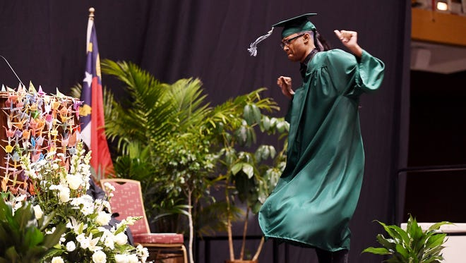 Donovan Johnson dances before receiving his diploma during Reynolds High School's commencement at the US Cellular Center June 16, 2018.