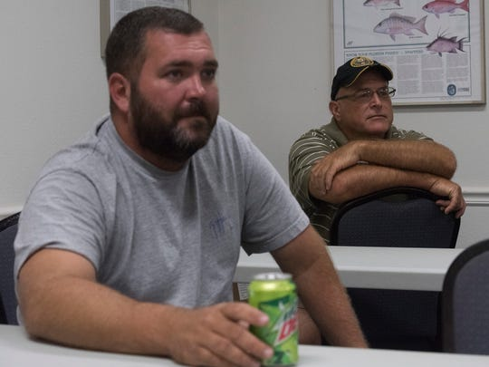Chris Williams, left, and Steven Kirkwood share their success stories after taking part in the Veterans Dive Locker program. The program is designed to teach recreational diving to disabled veterans.
