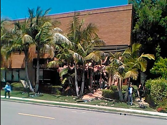 This image taken from cellphone video shows a building after a fatal explosion in Aliso Viejo on Tuesday.