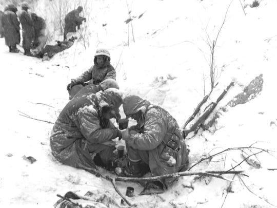 Members of the1st Marine Division at Chosin Reservoir in Korea, Dec. 1950.