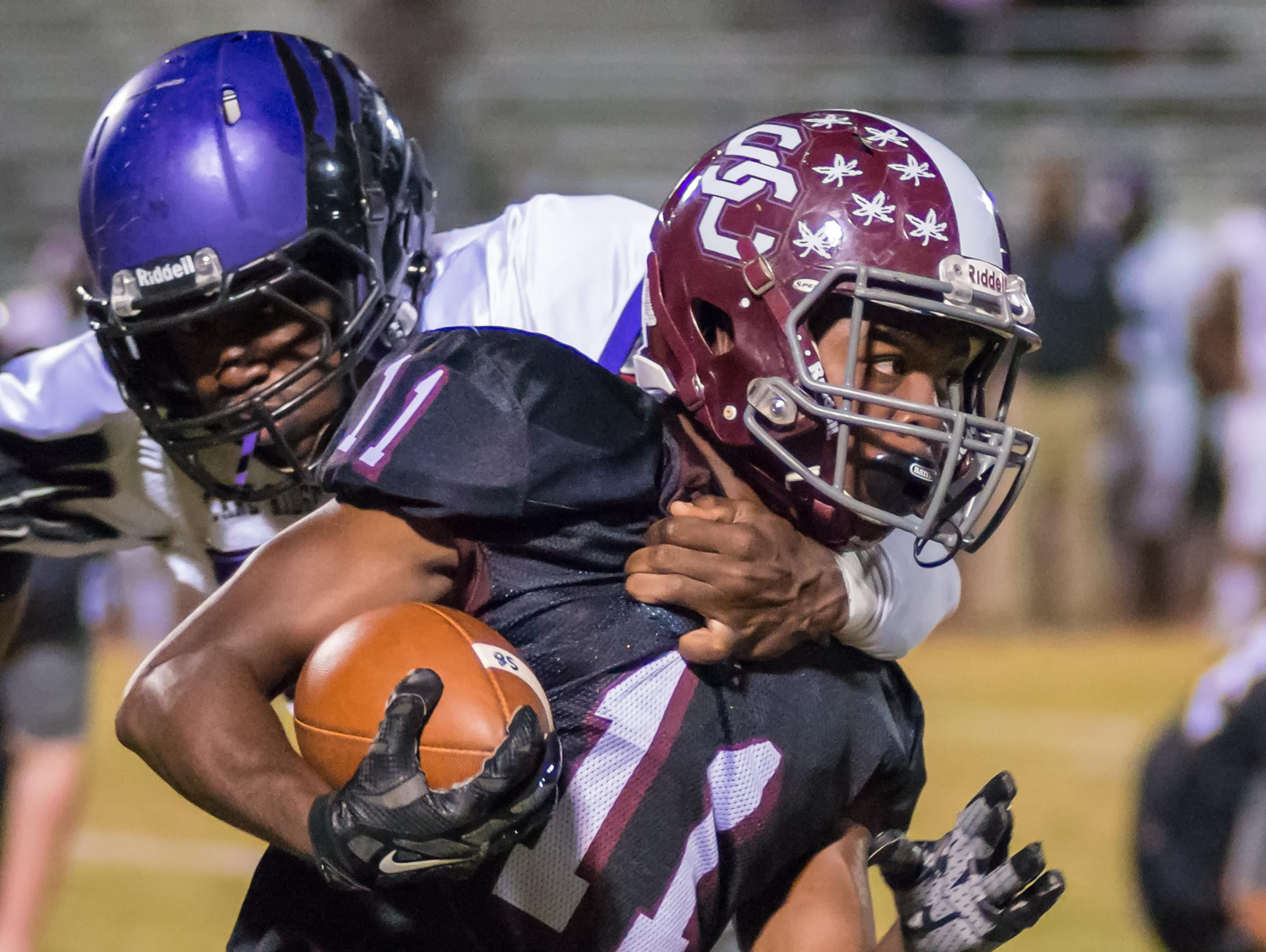 Station Camp High junior Marcus DeVault attempts to break free from the grasp of a Cane Ridge defensive player.