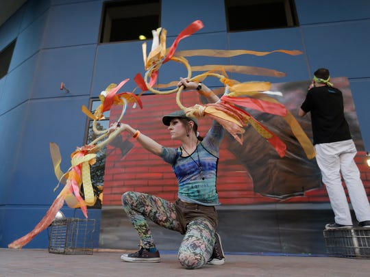 Performance artists entertain the crowd Saturday at the El Paso Downtown Street Festival.