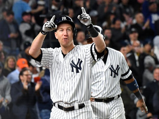 New York Yankees third baseman Todd Frazier (29) celebrates after hitting a three run home run during the second inning against the Houston Astros during game three of the 2017 ALCS at Yankee Stadium.