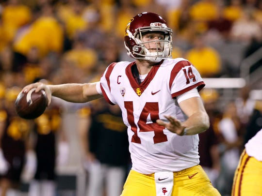 FILE - In this Saturday, Oct. 28, 2017 file photo, Southern California quarterback Sam Darnold throws a pass during the first half of an NCAA college football game against Arizona State in Tempe, Ariz. Southern California quarterback Sam Darnold will skip his final two seasons of eligibility to enter the NFL draft.