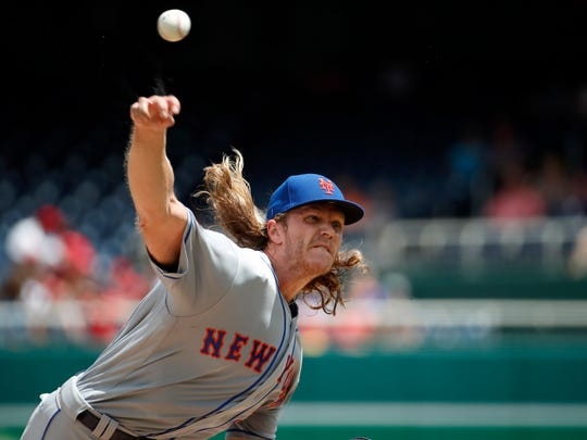 New York Mets starting pitcher Noah Syndergaard throws during the third inning of a baseball game against the Washington Nationals.