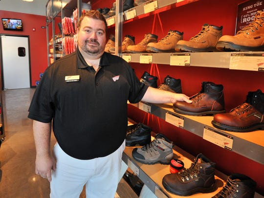 Store manager Dennis Garton, 33, of Wausau, poses for a photo Wednesday at Red Wing Shoes store in Wausau.