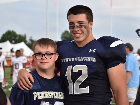 Forrest Rhyne stands with his buddy Aaron before the