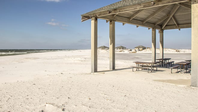 Picnic pavilions and restroom facilities stand at Opal Beach in the Santa Rosa Day Use Area of Gulf Islands National Seashore.