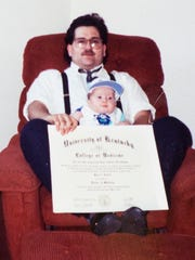 May 15, 1993: Dr. Kalfas holds his son Michael, who