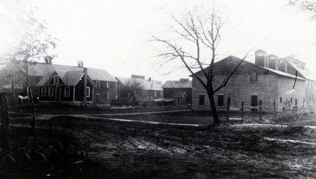 This circa 1909 photo shows the industries of Walker; on the left is the E.M. Upton Co. warehouse.
