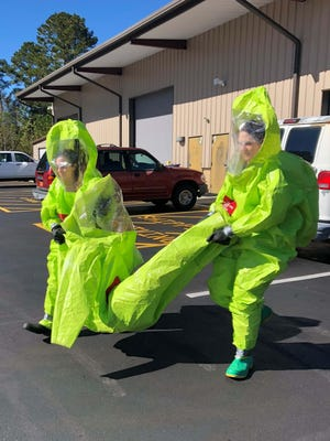 Craven CC students in the Environmental Safety program wear hazmat suits while training. It is one of numerous Workforce Development programs for which the college is reinstating in-person instruction.