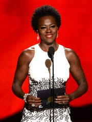 IMAGE DISTRIBUTED FOR THE TELEVISION ACADEMY - Viola Davis presents the award for outstanding supporting actor in a drama series at the 67th Primetime Emmy Awards on Sunday, Sept. 20, 2015, at the Microsoft Theater in Los Angeles. (Photo by Phil McCarten/Invision for the Television Academy/AP Images)