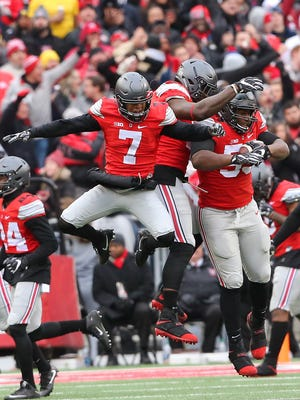 Ohio State Buckeyes defensive tackle Davon Hamilton (53) is congratulated by safety Damon Webb (7) and defensive end Jalyn Holmes (center) following his fumble recovery at the goal line during the third quarter.