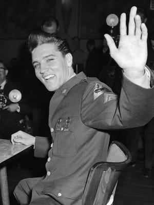 Elvis Presley, who flies home to get out of the Army, holds a news conference attended by over 150 reporters and photographers on March 1, 1960, in Friedberg, Germany. The rock 'n' roll singer will be discharged after two years of military service. Presley made sergeant and leader of a scout platoon of the U.S. Third armored division while in West Germany.