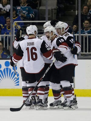 Arizona Coyotes right wing Shane Doan (19) celebrates with teammates after scoring a goal against the San Jose Sharks during the second period of an NHL hockey game in San Jose, Calif., Saturday, Feb. 4, 2017.