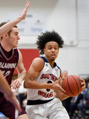University of Southern Indiana's Marcellous Washington (0) drives to the basket against defense from Bellarmine's Daniel Ramser (12) as the USI Screaming Eagles play the Bellarmine Knights at USI's Physical Activities Center Saturday, February 10, 2018.