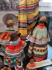 Indian dolls are displayed at the Museum of the Everglades in Everglades City on Tuesday, Aug. 2. The dolls are made from palmetto fiber and are popular souvenirs.