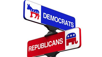 Street signs with Democrats and Republicans headed in opposite directions.