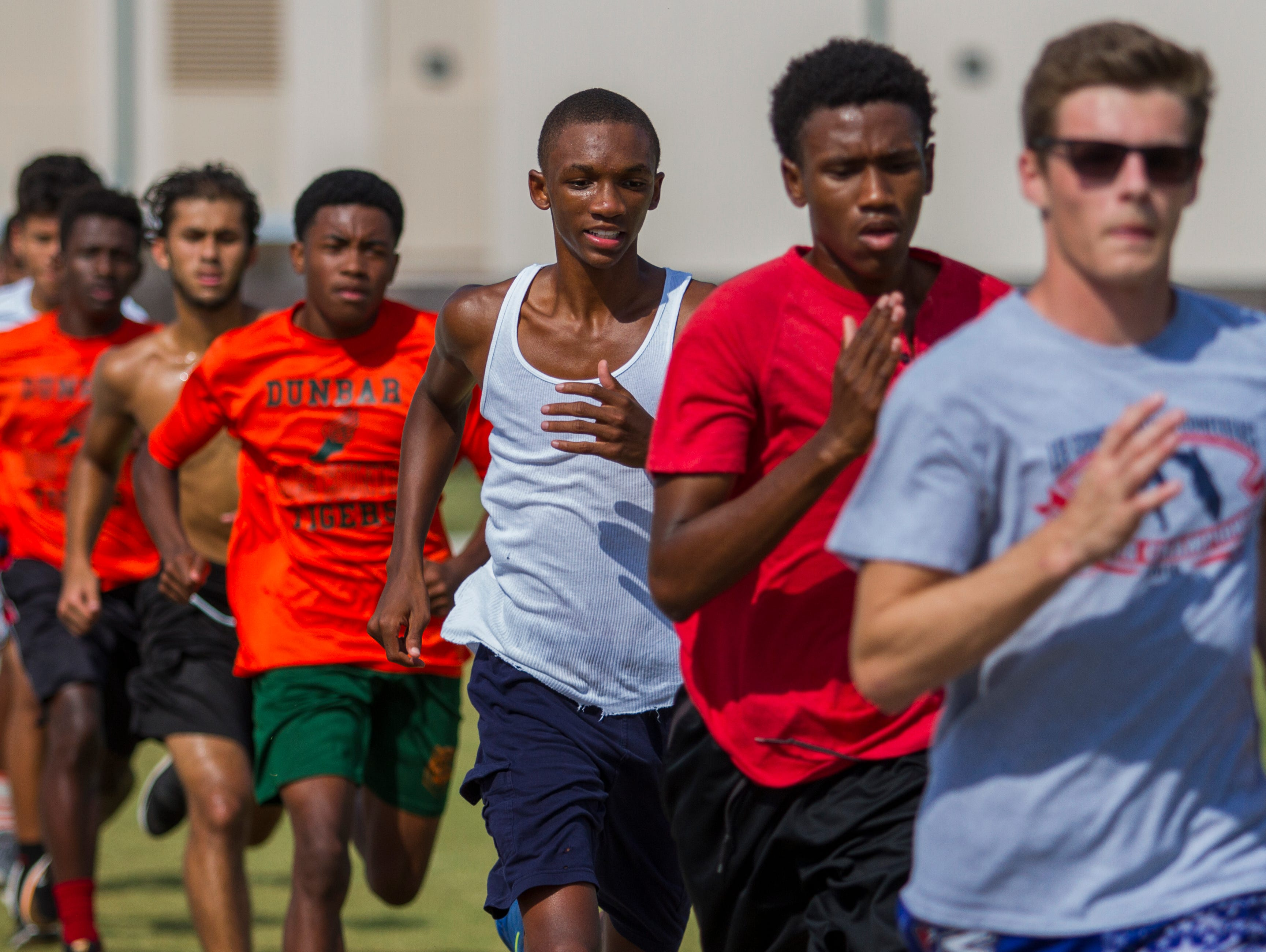Members of the Dunbar High School cross country team practice after school Wednesday, November 2, at their track in Fort Myers. The cross country team has qualified for its first state championship in school history.