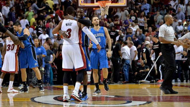 Heat guard Dwyane Wade (3) greets Orlando guard Victor Oladipo (5) after the Magic defeating the Heat at American Airlines Arena, Monday.