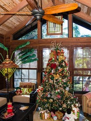 The 1940's home of Pati and Bob Mazzerella is the perfect setting for a beautiful Christmas tree.
