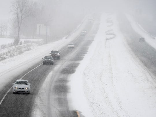 Traffic on the U.S. 41 By-Pass in Henderson as another