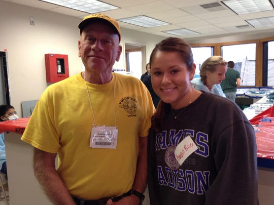 Waynesboro's Daniel Sullivan stands with JMU student volunteer Kendall Price at a RAM of Virginia clinic in Jonesville on Sept. 13, 2015. Sullivan volunteers as Registration Lead at RAM of Virginia, and Price is part of Professor Laura Hunt Trull's class Rural Health: An Interprofessional Approach.