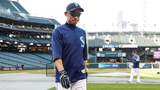 Ichiro Suzuki walks off the field after batting practice Thursday before the Mariners game against the Athletics at Safeco Field.