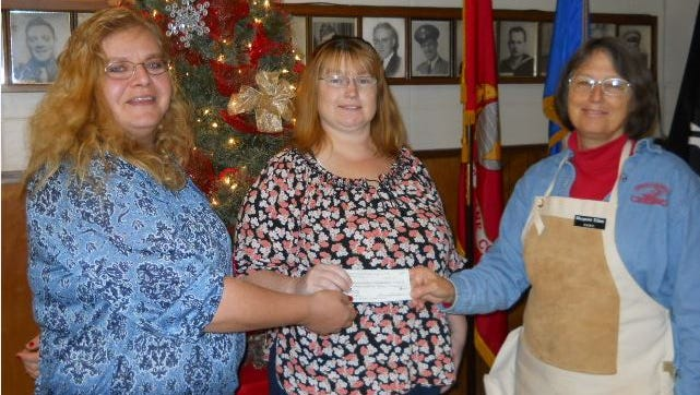Shawn Pope, Humane Society of North Central Arkansas board president and Carolyn Carter, shelter manager, accept a check for $400 from Margaret Killen, First Lady of the NAWC.