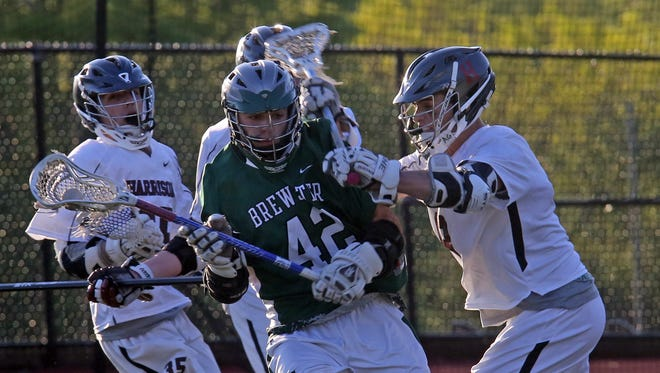 Brewster defeats Harrison 13-12 during boys lacrosse Section 1 Class B playoff game at Harrison High School on May 16, 2016.
