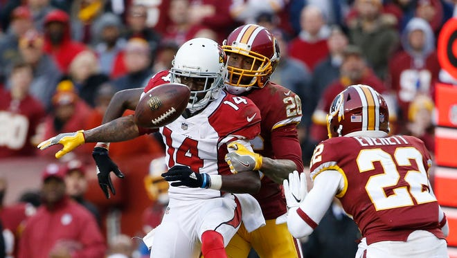 Washington Redskins cornerback Bashaud Breeland (26) breaks up a pass intended for Arizona Cardinals wide receiver J.J. Nelson (14) in front of Redskins strong safety Deshazor Everett (22) during the second half at FedEx Field. The Redskins won 20-15.