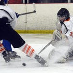 Jake Price kept the Bulldogs in the game with his goaltending in Saturday's loss to Detroit Catholic Central.
