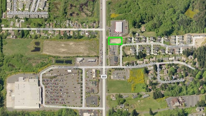 The Taco Bell project site is outlined in green.