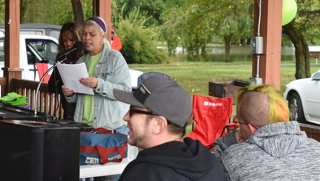 Michelle Gilmore speaks during the 4th annual Ross County Recovery Rally Thursday in Yoctangee Park.