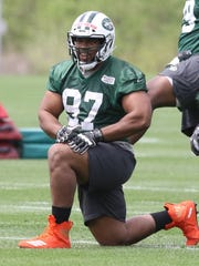 Third round draft pick Nathan Shepherd works out at defensive line during rookie camp.