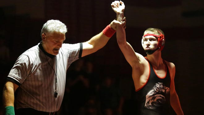 Joe Cliver of Hortonville celebrates a win during a Fox Valley Association wrestling match in December.