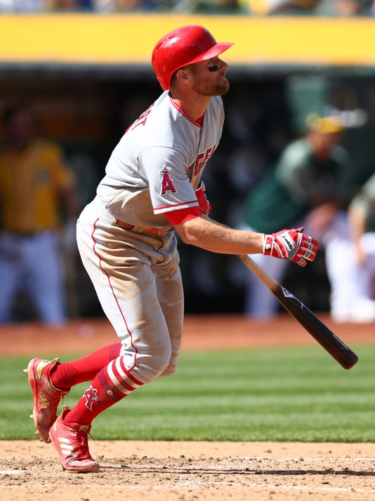 Los Angeles Angels' Zack Cozart watches his two-run double hit off Oakland Athletics' Liam Hendriks in the sixth inning of a baseball game on Saturday, March 31, 2018 in Oakland, Calif. (AP Photo/Ben Margot)