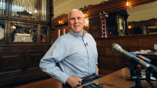 Mike Pence spoke to the media in 2011 at the historic Zaharakos ice cream parlor in his hometown of Columbus, about his plans to run for governor.